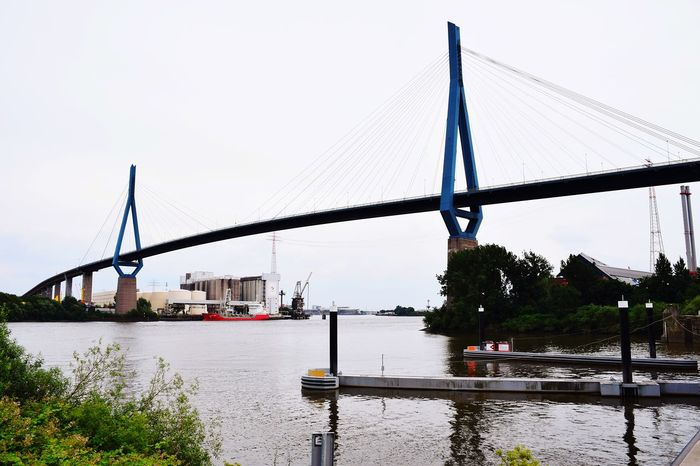 Nature Waterfront Beauty In Nature Sunlight Sunshine ☀ Day Outdoors Focus On Foreground River Elbe ♥️ Water City Bridge - Man Made Structure Sky Built Structure Suspension Bridge Cable-stayed Bridge Bridge Steel Cable Boat