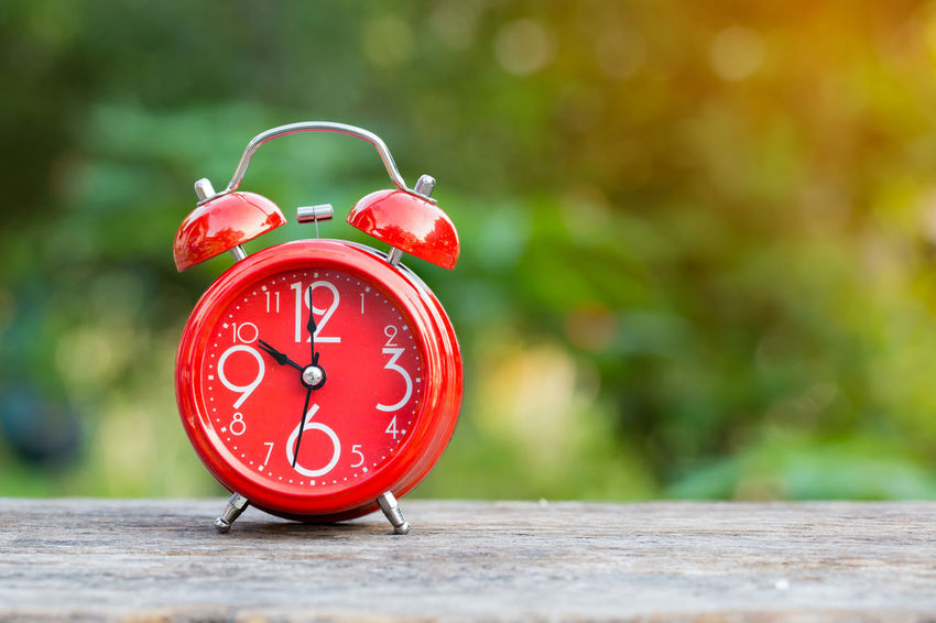 alarm clock on nature background Nature Alarm Clock Clock Clock Face Close-up Hour Hand Minute Hand No People Outdoors Red Time