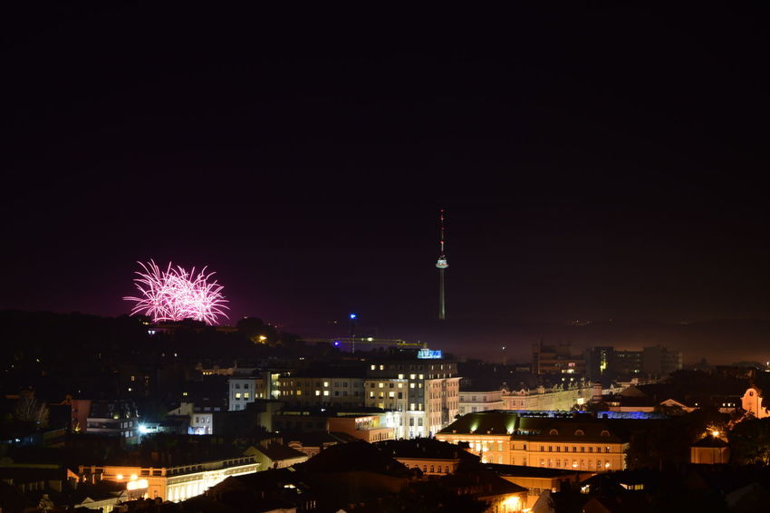 Vilnius Fireworks festival Architecture Celebration City City Life Cityscape Communications Tower Copy Space Dark Development Exploding Firework Display Illuminated Night Outdoors Skyscraper Spire  Tourism Tower Travel Destinations Urban Skyline Vilnius Fireworks Festival
