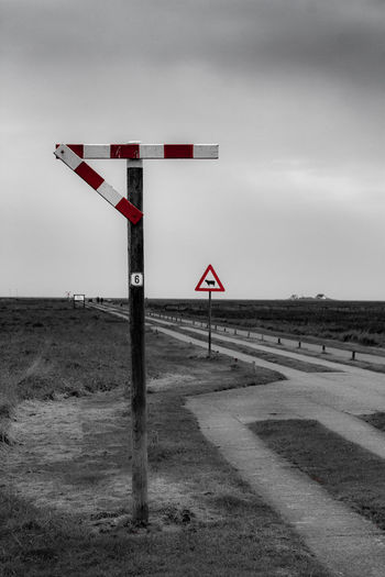Sky Road Sign Nature No People Communication Road Sign Transportation Day Guidance Safety Cloud - Sky Land Warning Sign Field Outdoors Environment Security Landscape Nature Sheep Sign Signs Signal Deich  EyeEmNewHere