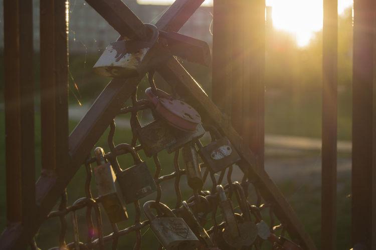 Locks Of Love Locks Of Love Bridge Outdoors From My Point Of View By Ivan Maximov Lock Gates Railing Railings And Iron Railing On The Bridge Lock On Bridge Grodno, Belarus Sunset Evening Light Lens Flare Close-up Sunbeam Sunrise Light Beam Solar Flare Sun