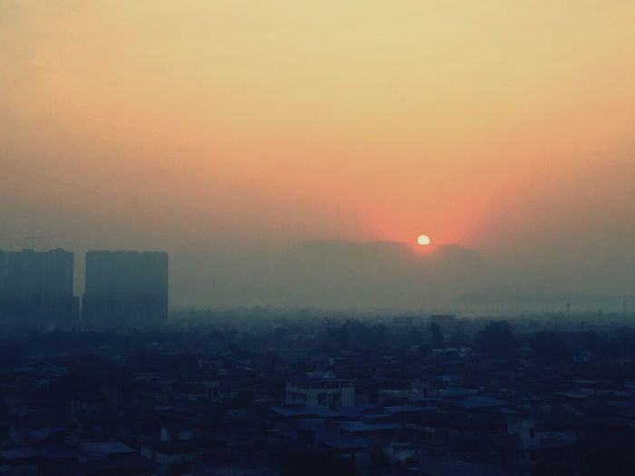 Sunset Smog City Fog Sky Sun Outdoors Nature Cityscape High Angle View No People Urban Skyline Architecture Travel Destinations Social Issues Building Exterior Skyscraper Day First Eyeem Photo