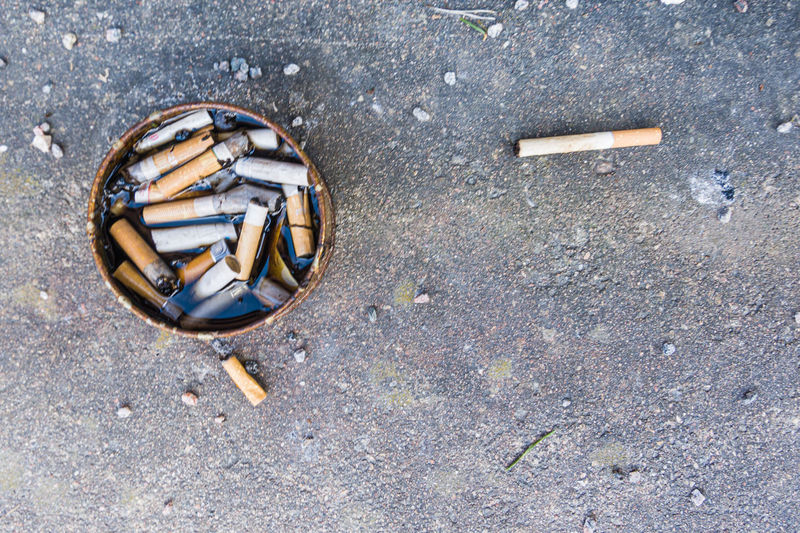 High angle view of cigarette on street
