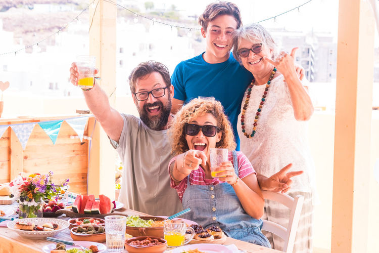 Portrait of cheerful family enjoying during lunch