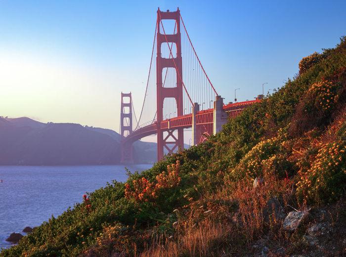 Bridge over river against sky during autumn
