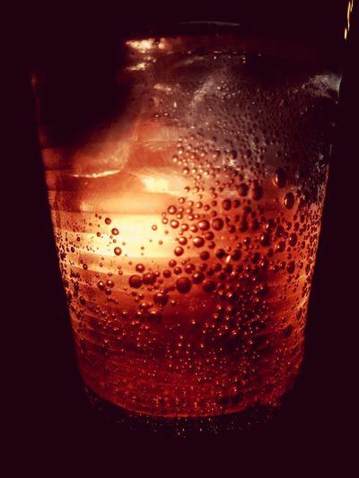 Close-up of drink against black background