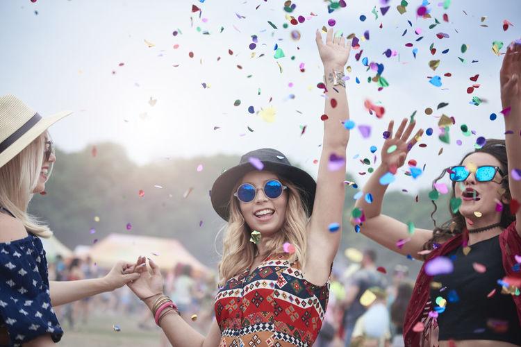 Happy friends enjoying at music concert