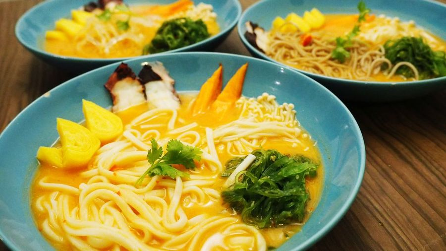 Close-Up Of Noodle Soups Served On Table