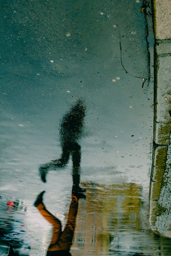 Running in the rain. [63/365] 2016.12.11 Leisure Activity Men One Man Only One Person Outdoors People Puddle Puddleography Real People Reflection Reflection Reflections Running Water Wet Wetness