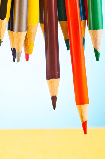 colourful pencils over beautiful reverberation gradient background Multi Colored No People Yellow Close-up Pencil Orange Color Still Life Studio Shot Writing Instrument Nature Art And Craft Sky Focus On Foreground Indoors  Day Choice Vibrant Color Hanging Variation Colored Pencil Art And Craft Equipment