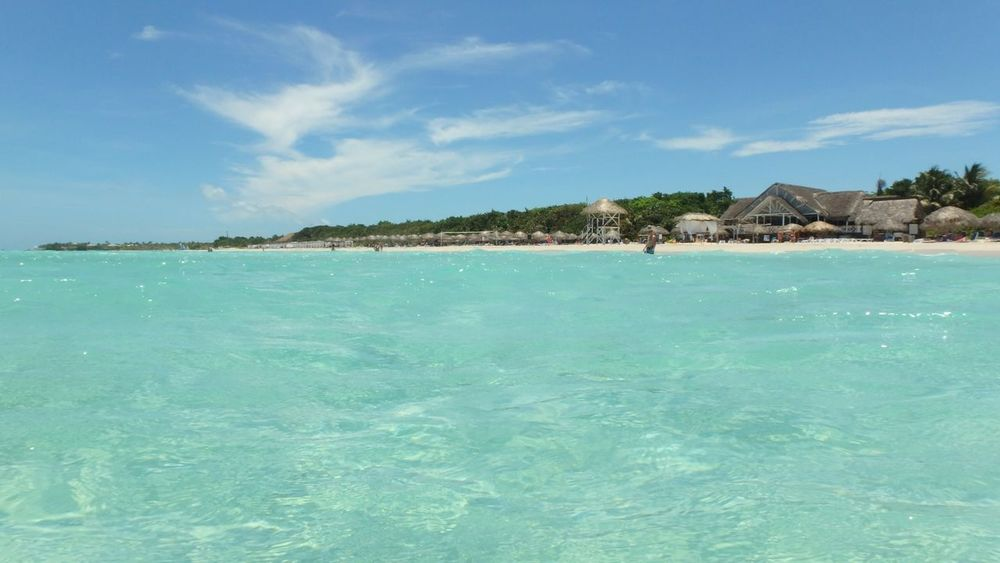 Cristal Clear Sea of Cuba Varadero Sea Turquoise Colored Thatched Roof Island Tourist Resort Tropical Climate Beach Coastline Idyllic Water Vacations Scenics Sky Hut Reef Luxury Blue Sand Nature Olympus TG 860 Cuba Bringmebacktocuba! Vacations