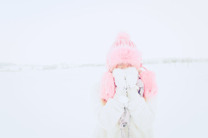 Blond Cold Temperature Enjoying Life Eylashes Face Fake Freezing Fun Fur Girl Hat Fur Headshot Lash One Person Pink Color Smile Snow Toothy Smile Warm Clothing White Winter Young Adult