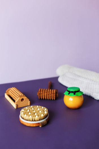 Close-up of orange on table against blue background