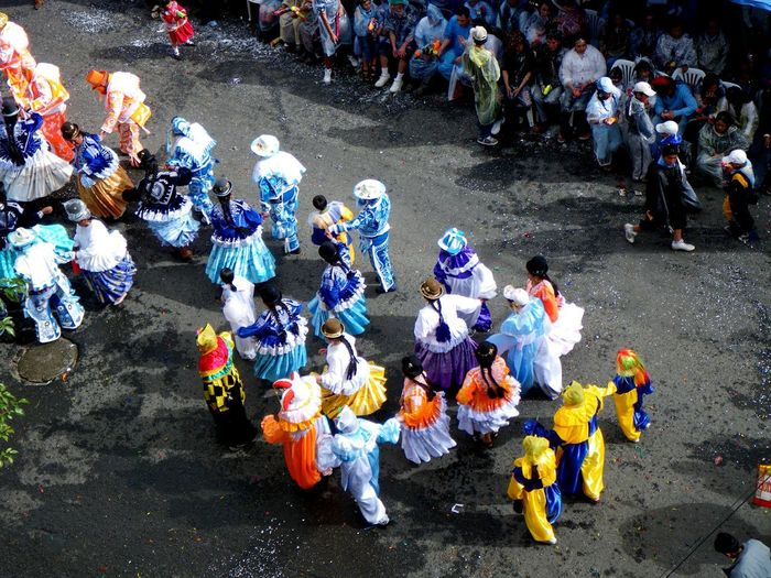 High angle view of people in traditional costumes walking at pacena parade