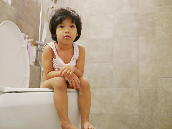 Little Asian baby girl, 38 months old, learning to go, get on, and use adult size toilet bow by herself successfully for the first time Baby Girl Asian  Sitting Training Potty Toilet Bowl Adult Size Child Kid Toddler  Successfully Success Happy Proud By Herself Able To Bathroom Restroom House Home Routine Morning Use