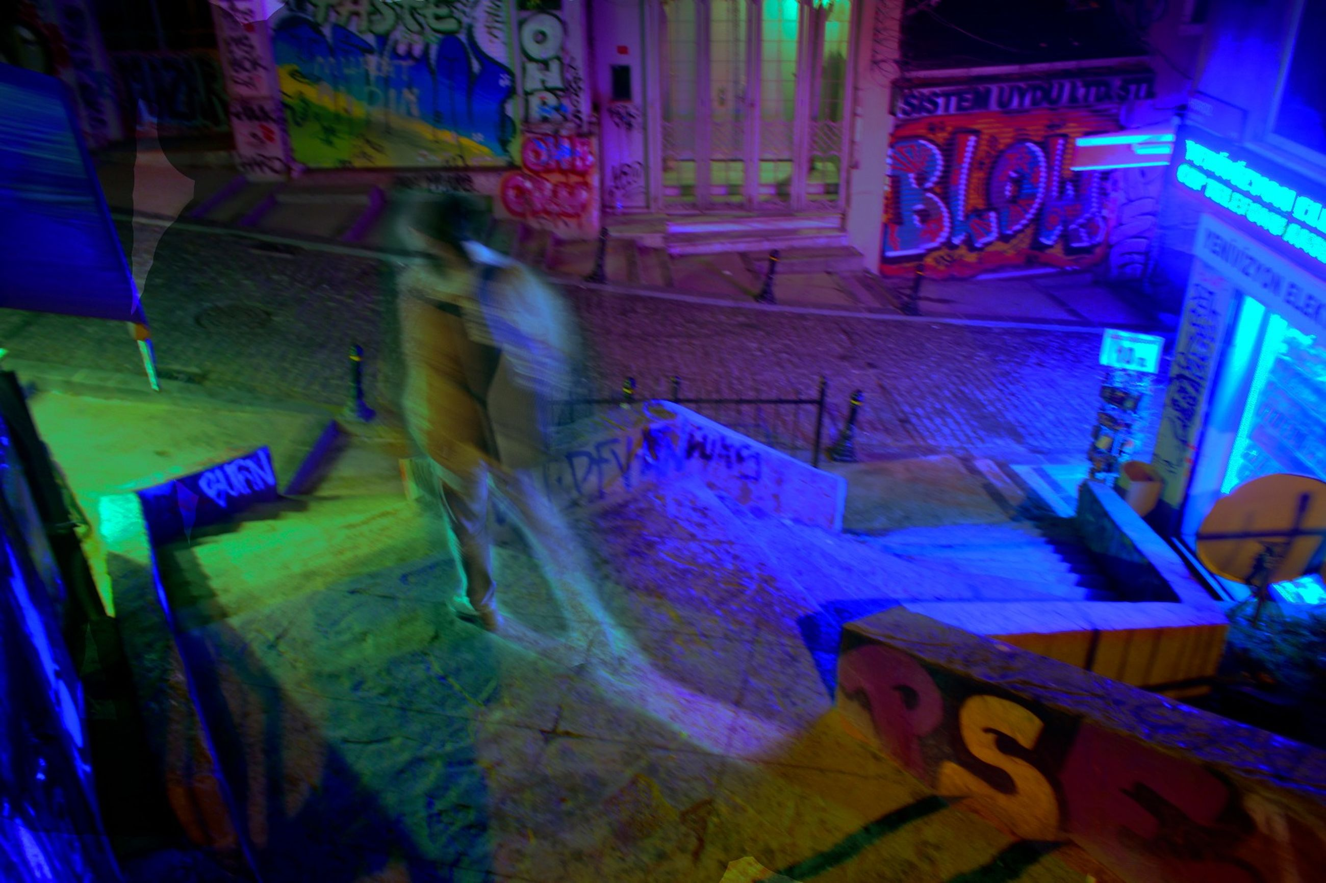 real people, illuminated, lifestyles, multi colored, night, blurred motion, full length, indoors, architecture, one person, men