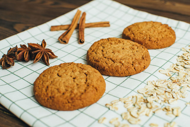 High angle view of cookies by spices on table
