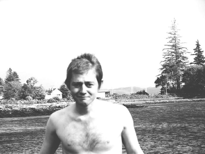 One Person Portrait Young Adult Real People Shirtless Looking At Camera Traveller Backpacker Traveling Travelling ✈ Nomads Travel Isle Of Skye Isleofskye Scotland Scotland Outdoors Water People Front View One Man Only Only Men Adults Only Sky