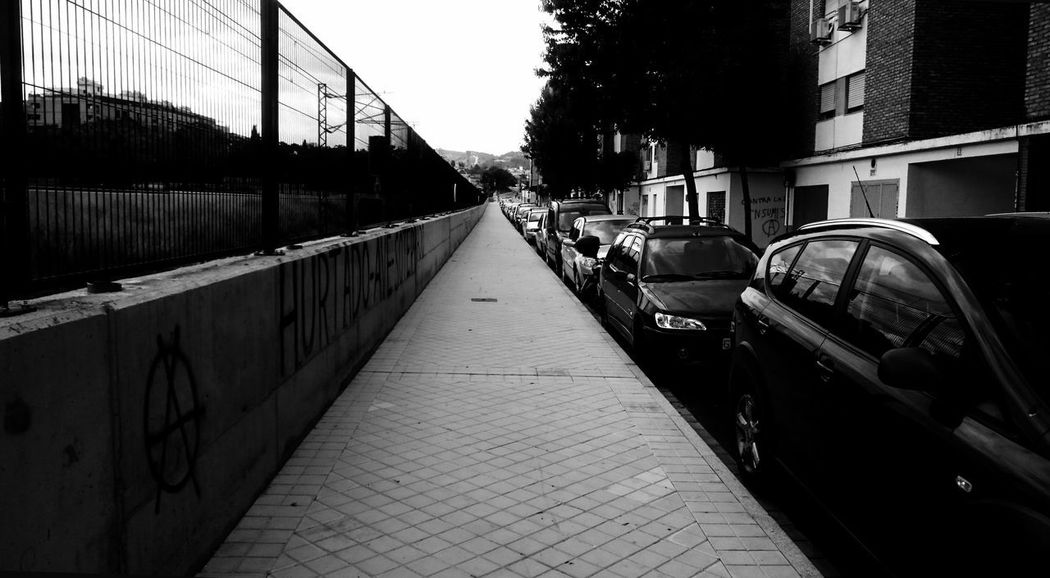 In A Row Architecture Barrier Black And White Blackandwhite Bridge Bridge - Man Made Structure Building Exterior Built Structure Canal Car City Connection Day Direction Land Vehicle Mode Of Transportation Monochrome Motor Vehicle No People Outdoors Railing Street Transportation