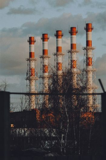 Factory against sky at dusk