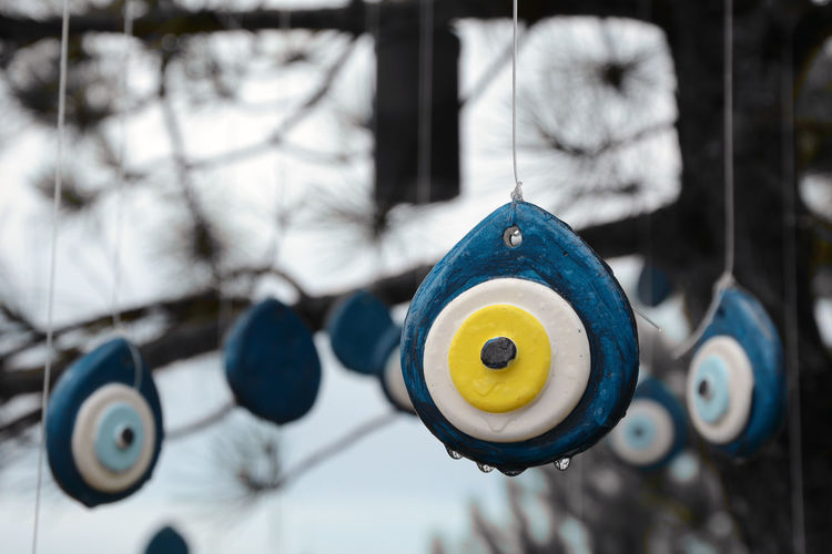 Close-up of stuffed toy hanging on metal