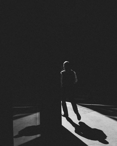Shadow of woman standing on floor