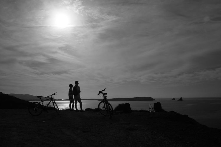 Looking At The Sea Beauty In Nature Bicycle Blackandwhite Cloud - Sky Cycling Day Leisure Activity Lifestyles Looking Men Nature Outdoors Real People Scenics Sea Silhouette Sky Sun Sunbeam Sunlight Togetherness Two People Vacations Water