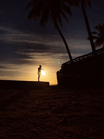 Sunset Real People Full Length Beach Silhouette One Person Sea Sand Lifestyles Tranquil Scene Leisure Activity Beauty In Nature Outdoors Nature Horizon Over Water Scenics Palm Tree Sky People Day EyeEmNewHere EyeEmNewHere Art Is Everywhere The Great Outdoors - 2017 EyeEm Awards BYOPaper!