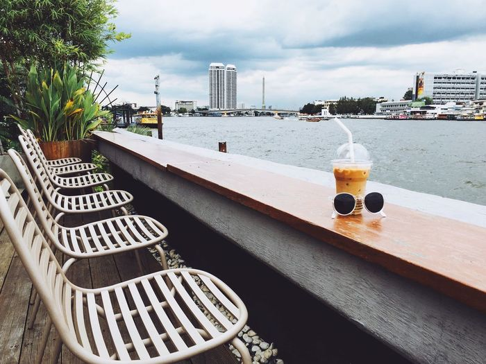 Coffee Coffee Time Cafe Icedcoffee Iced Drink Sunglasses Summer Summertime Outdoors Riverside River Bangkok Chao Phaya River Chair Relaxing Coffee Break Iced Latte Cool Drinks Bar View Scenics Nature Season