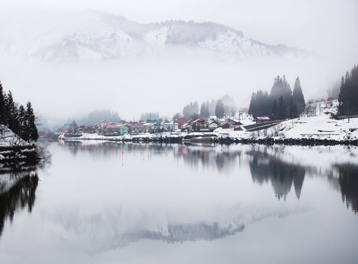 Water Winter Reflection Cold Temperature Beauty In Nature Scenics - Nature Fog Tranquility Building Exterior Waterfront Architecture Building Day No People Nature Mountain Sky Built Structure Outdoors Houses Mist