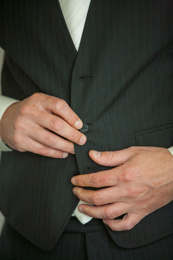 Detailed shot of businessman getting ready