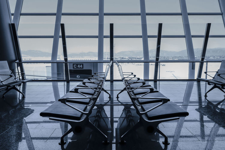 at gate 44 Airport Architecture Architecture_collection Bench Empty Flughafen Gate Modern Monochrome No People Pattern Reflection Row Seating Bench Sitzbank Sitzreihe Sky Terminal Urban Wartebereich