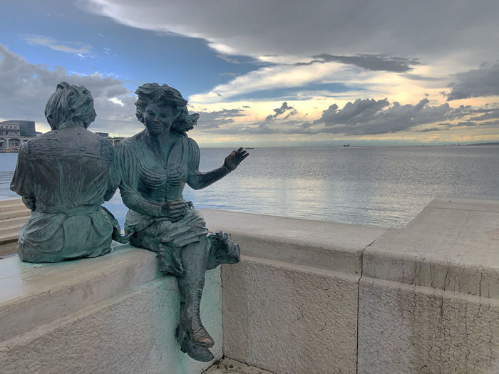 Statue of sea against sky during sunset