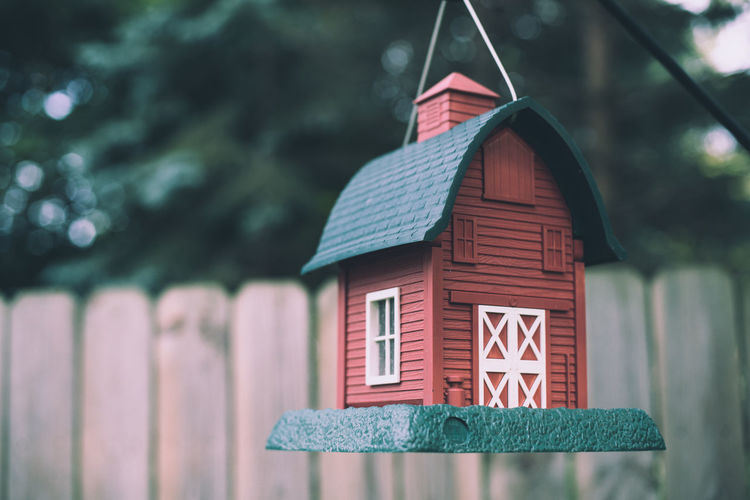 Close-up of birdhouse hanging in yard