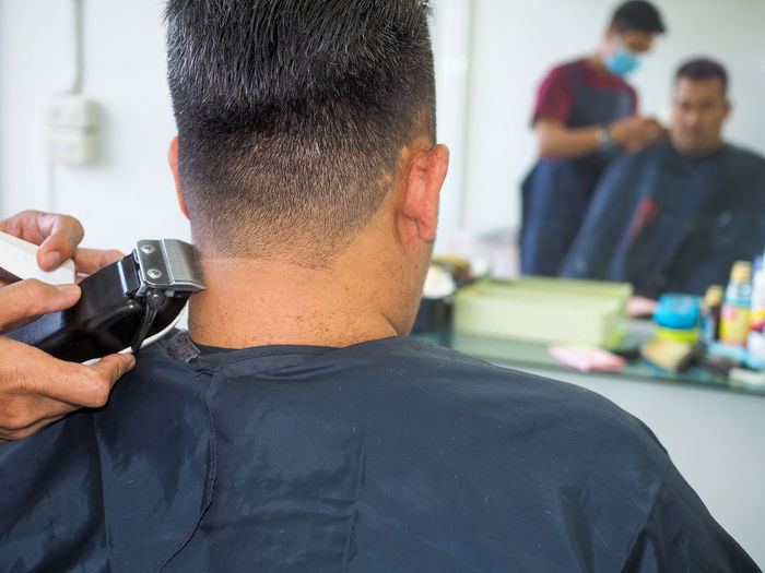 Hairdresser hairstyling male customer