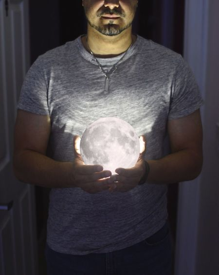 Moonlight Holding One Person Indoors  Illuminated Real People Standing Young Adult Human Hand Close-up Day Adult People Moon Indoors  Standing Being Creative. Being Creative Being Artistic Casual Clothing