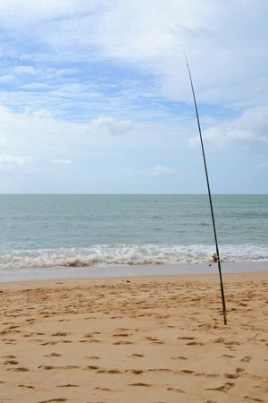 Beach Sand Sea Water Cloud - Sky Tranquility Nature Horizon Over Water Sky Day No People Outdoors Scenics Vacations Beauty In Nature Fishing Life Fishing Time Fishinglife Fishing Pole Fishing