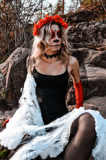 Closeup portrait of calavera catrina. young woman with sugar skull makeup and white spiderweb. dia