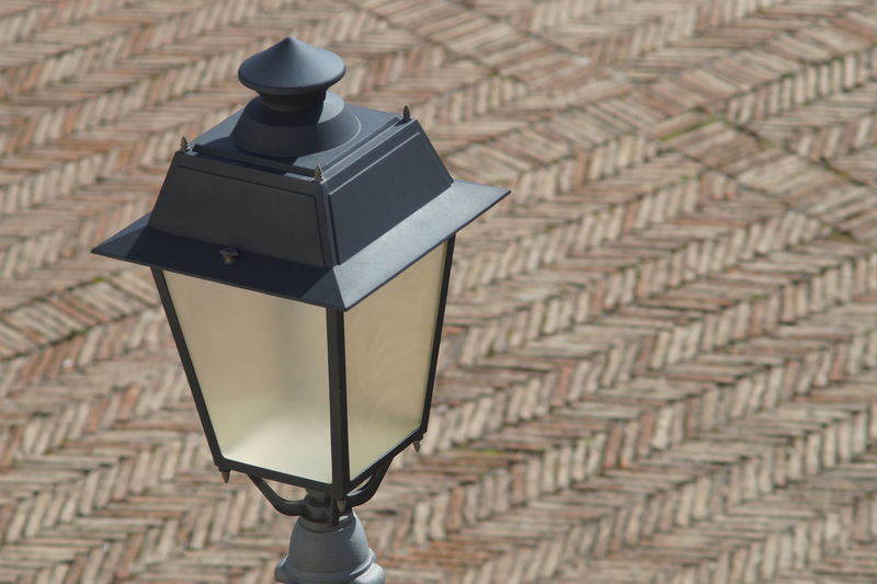 Close-up of electric lamp in city