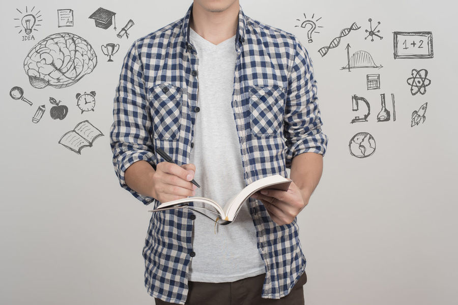 close up of university student male with education icon Adult Book Close-up Collage Draw Education Graduation Idea One Person Pen People Photography Student Think University White Background