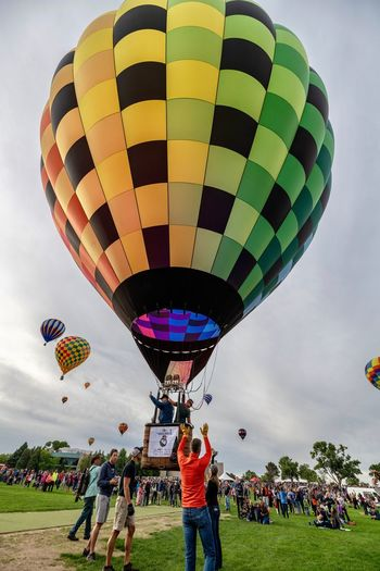 Takeoff Hot Air Balloon Group Of People Multi Colored Balloon Real People Leisure Activity Men Hot Air Balloon Air Vehicle Flying Lifestyles Cloud - Sky Mid-air Outdoors People Women Crowd