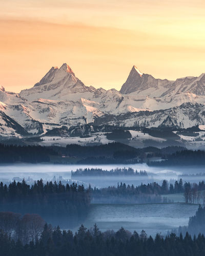 Beauty In Nature Scenics - Nature Sky Mountain Tranquil Scene Tranquility Sunset Fog Environment Idyllic Cold Temperature Mountain Range Landscape Non-urban Scene Winter No People Cloud - Sky Hazy  Nature Snowcapped Mountain Schreckhorn Finsteraarhorn Emmental Bern