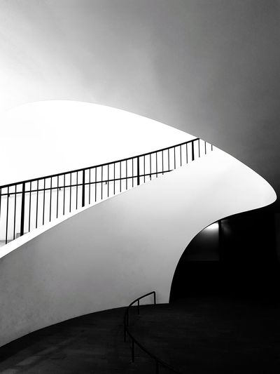 Staircase in modern building against sky
