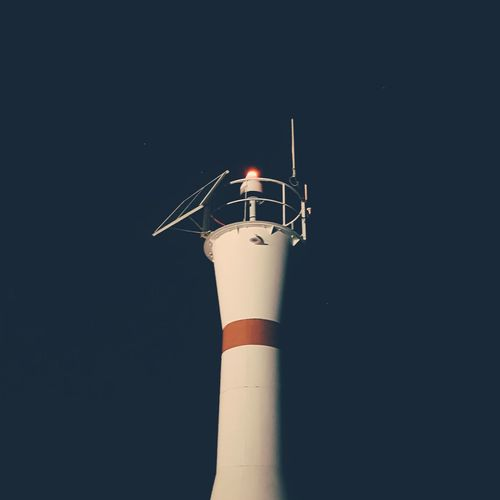 lighthouse Night Nightphotography Lighthouse Night Lights Dark Solid EyeEm Selects Factory Smoke Stack Business Finance And Industry Fumes Industry Close-up Windmill