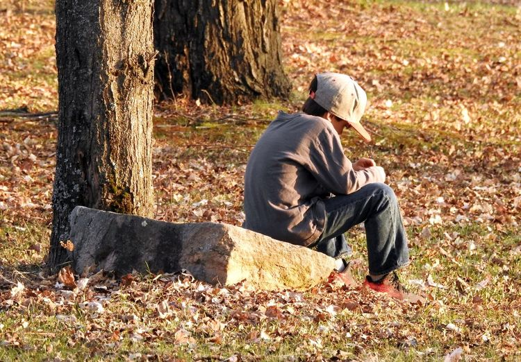 """ Between A Rock & A Hard Place "" * * * * Alone Autumn Leaves Boy Contemplating Life Boy Sitting On Big Rock Autumn Big Rock Boy Siting Alone Boy Sitting Alone Day One Person Outdoors Serious Thinking Sitting Tree Trunk"