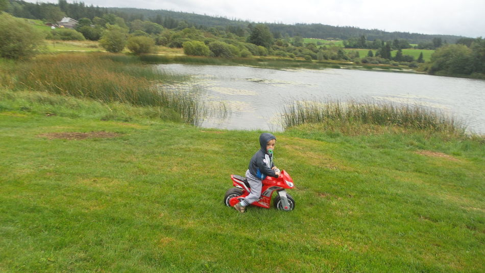 EyeEm Selects Water Grass Childhood Child Motorcycle Outdoors One Boy Only Tree Children Only Nature Mylove ❤️ Proud Mommy