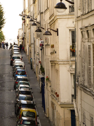 Paris streets Montmartre City Architecture Building Exterior Street Transportation Built Structure Mode Of Transportation Incidental People Motor Vehicle Land Vehicle Car Road Day Building The Way Forward Traffic In A Row City Life Outdoors Direction Montmartre Paris Montmartre, Paris