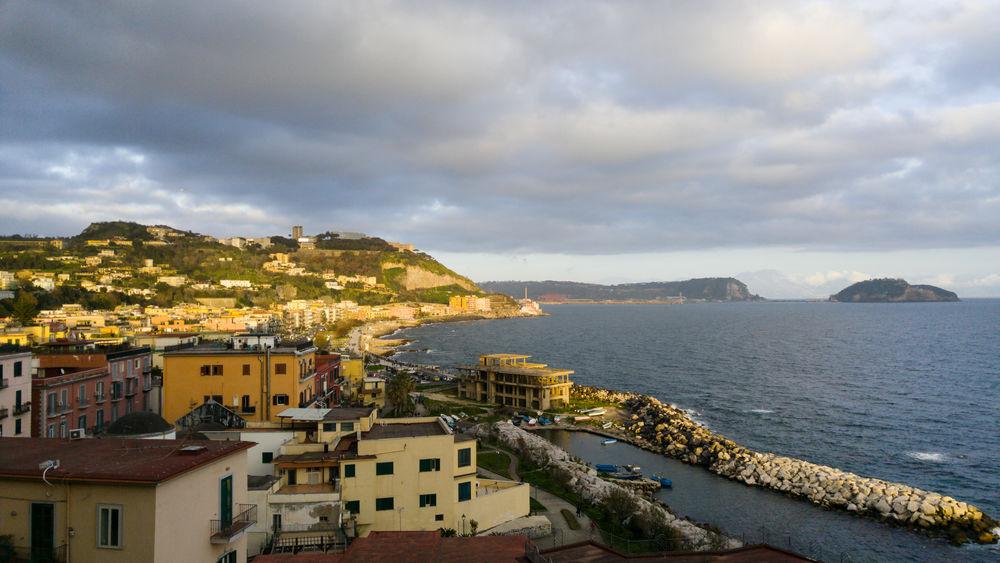 Pozzuoli coastline at sunset, Naples, Italy Bay Of Naples Coastline Naples, Italy Nature South Italy Beauty Italian Italy Nisida Nisida Island Pozzuoli Sea Sunset Town Village