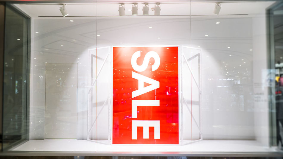 sale banner in front of store shop Advertising Sale Advertisement Business Finance And Industry Close-up Communication Day Discount Illuminated Indoors  No People Red Text