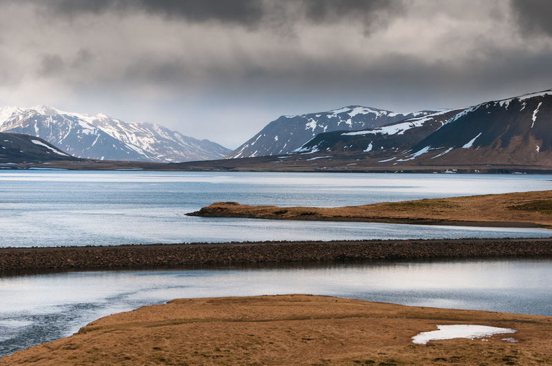 Landscape with frozen lake and mountains covered in snow  in iceland in wintertime.